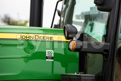 Closeup of an agricultural tractor by John Deere Stock Photo