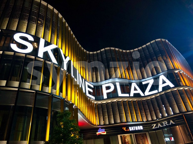Frankfurt am Main, Germany - August 08, 2018: Skyline Plaza shopping and wellness center at night with colourful illumination.