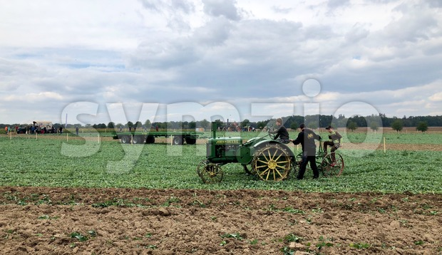 Kirchentellinsfurt - September 1, 2018: Children can learn how to drive an old tractor and plow during the World Ploughing ...