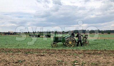 Children learn how to use an old tractor and plow during the World Ploughing Competition in Germany 2018 Stock Photo