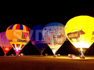 The glow of hot air balloons at night during the World Ploughing Competition in Germany 2018 Stock Photo