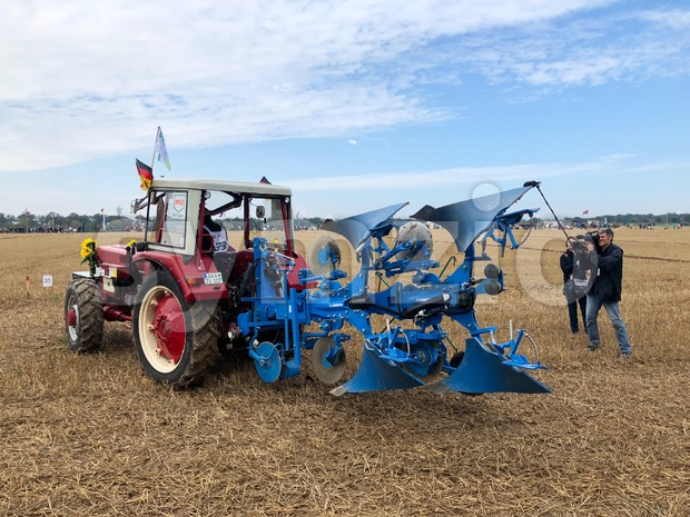 Kirchentellinsfurt - September 1, 2018: International contestants with their tractors are plowing their plots during the World Ploughing Competition 2018 ...