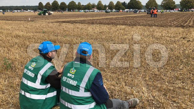 Plot Stewards waiting alongside the World Ploughing Competition in Germany 2018 Stock Photo