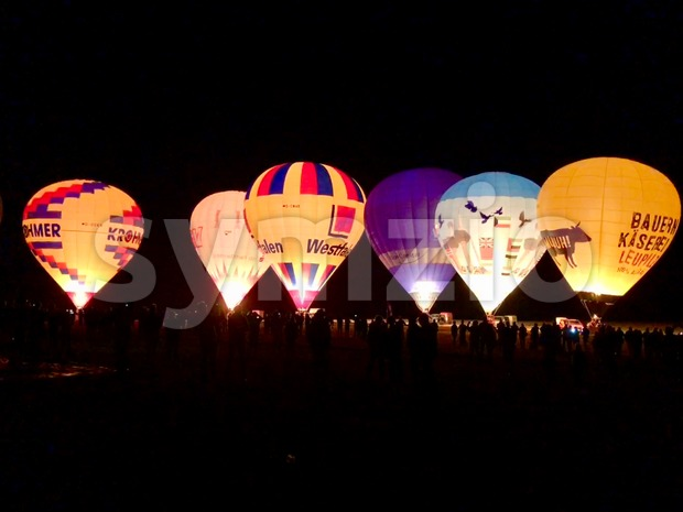 Kirchentellinsfurt - September 1, 2018: Hot air balloons are performing a night glow during the World Ploughing Competition 2018 in ...