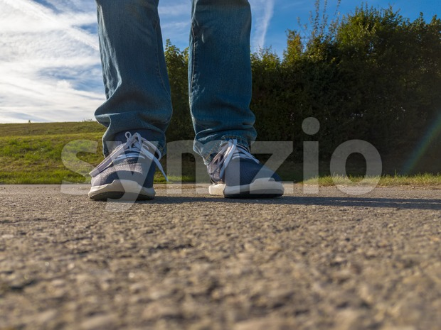 man feet on cobbled road Stock Photo
