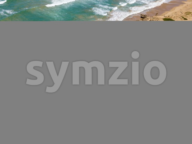 Waves and a dramatic untouched beach in South Africa Stock Photo