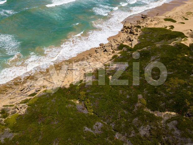 Aerial of waves and a dramatic untouched beach in South Africa
