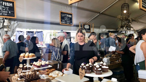 Cape Town, South Africa - November 17, 2018: Booth selling delicious sweets at a Neighbourgoods Market at the waterfront of ...