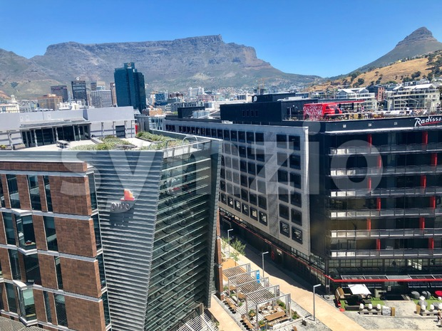 Cape Town, South Africa - November 18, 2018: The Cape Town waterfront with PWC offices and Radisson hotel overlooked by ...