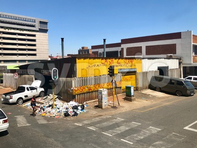 A scrap dealer is housing its garbage on the streets of Johannesburg, South Africa Stock Photo
