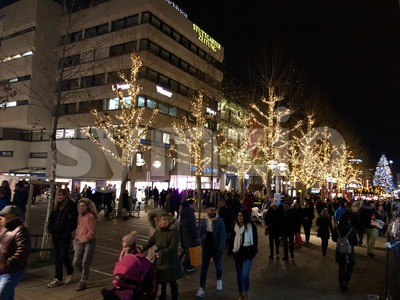 People are walking through the city and the Christmas market Stock Photo