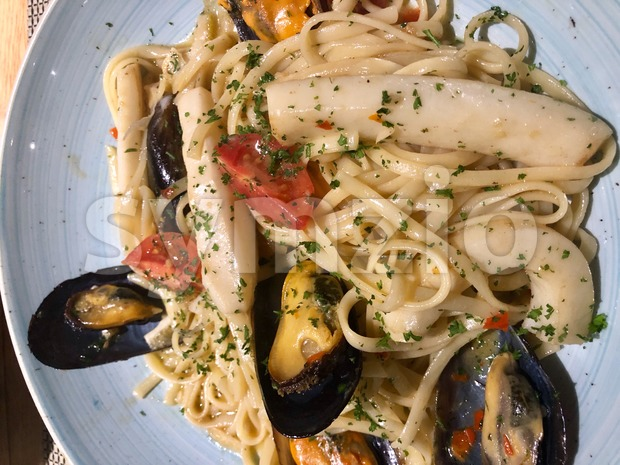 Seafood Pasta with mussels and octopus Stock Photo