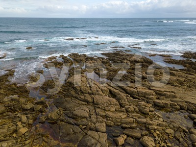 Aerial view of ocean waves and rocky coast Stock Photo