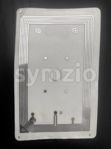 closeup circuit and antenna inside RFID card Stock Photo