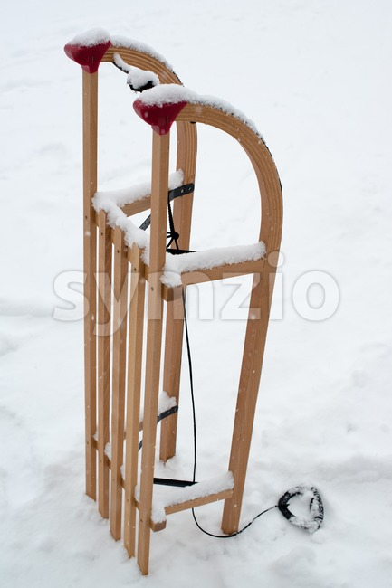 Wooden sled for a kid Stock Photo