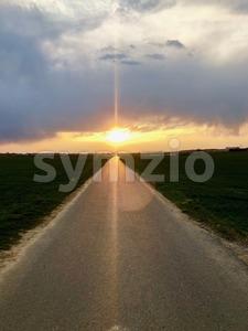 Sunset light above asphalt road Stock Photo