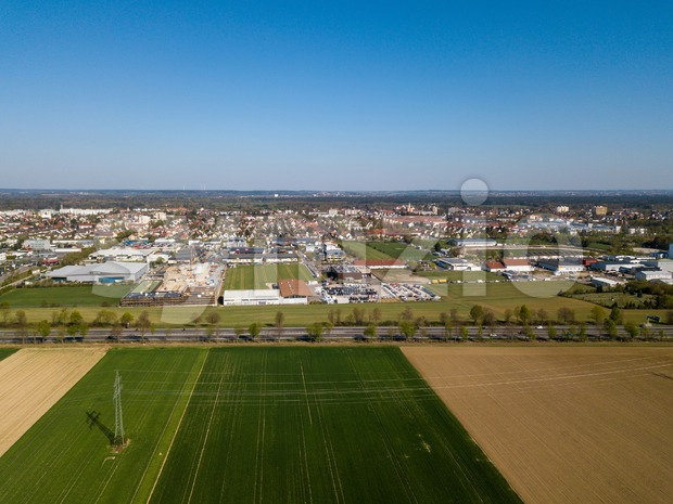 Aerial drone view of Haunstetten, a suburb of Augsburg in Germany. View over the federal Highway B17 towards the commercial ...