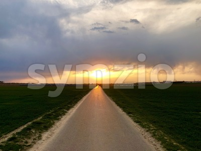 Sunset light above asphalt road Stock Photo