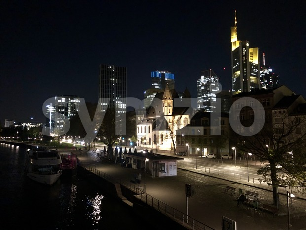 View from Eiserner Steg bridge at the skyline of Frankfurt City at night