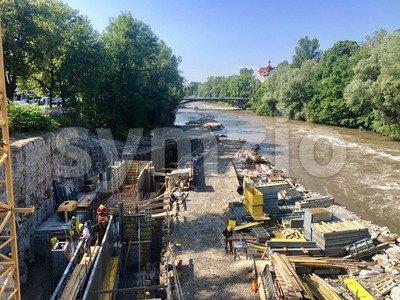Construction site beneath river Murr in Graz, Austria Stock Photo