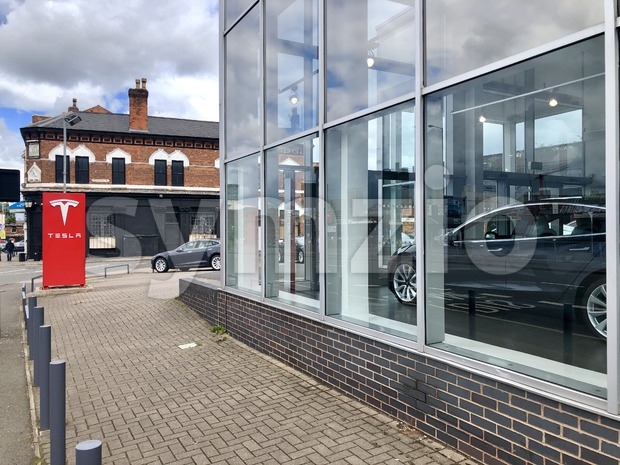 Birmingham, Great Britain - May 27, 2019: Tesla Dealership with Tesla Model S and Model X electric cars parked in ...