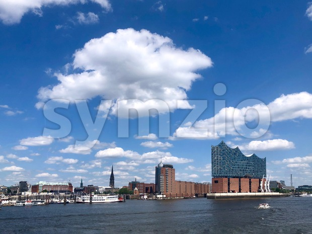 Hamburg - Harbor area with famous Landungsbruecken pier and the neighboring storehouse district Speicherstadt Stock Photo