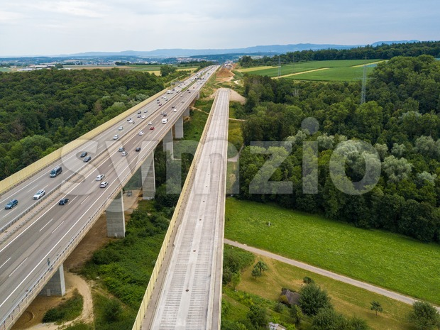 Aerial view of a German Autobahn with construction works for a new railway bridge besides. Drone photo taken at Denkendorf ...