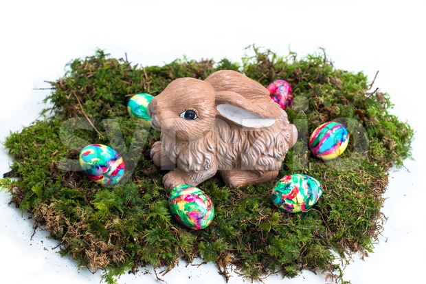 Easter Decoration: Painted Eggs and Rabbit on Moss Stock Photo