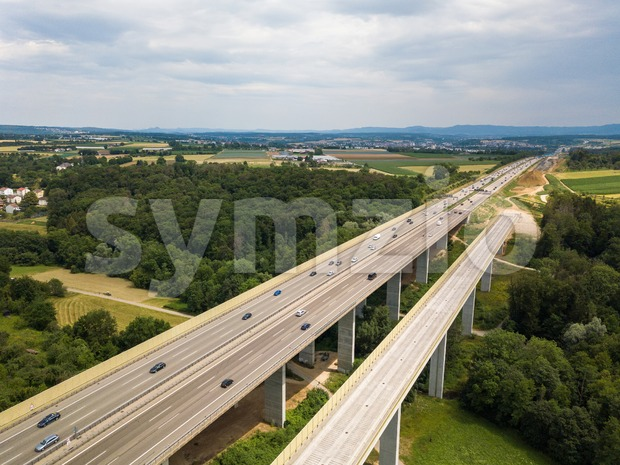 Aerial view of a German Autobahn with construction works for a new railway bridge next to it. Drone photo taken ...