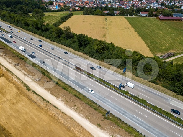 Aerial view of a German Autobahn with construction works for a new railway track next to it. Drone photo taken ...