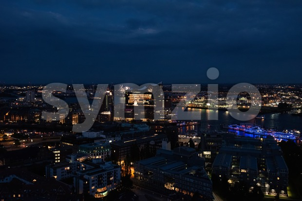 View of the harbor and the new Elbphilharmony of Hamburg at night Stock Photo