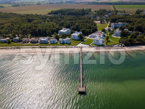 Aerial view on the sea bridge and the beautiful historic white houses in Heiligendamm in Bad Doberan at the baltic ...