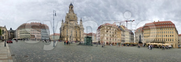 Dresden, Germany - August 12, 2019: The rebuilt Church of Our Lady (Frauenkirche) in Dresden, Germany with surrounding historic buildings.