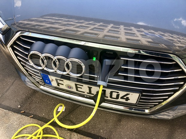 An Audi A3 e-tron plug-in hybrid car charging in the streets of Leipzig, Germany. Stock Photo