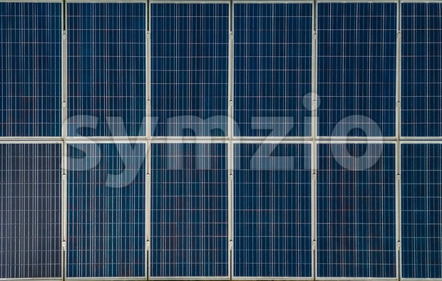Aerial view of solar panels in solar farm for green energy taken directly from above using a drone