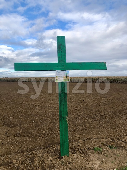 Ostfildern, Germany - October 2nd, 2019: A green cross with applied message is mounted on a field near Stuttgart in ...
