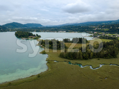 Aerial view on Lake 'Faaker See' in Carinthia (Kaernten), Austria with its famous turquoise water on a cloudy summer day Stock Photo
