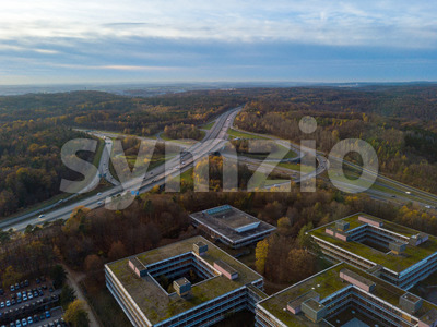 Aerial view over the famous Eiermann Campus in Stuttgart over the highway A8 towards Leonberg. The Eiermann Campus was planned by famous Bauhaus Stock Photo