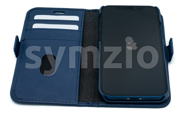 Ostfildern - Germany, December 5, 2020: Apple iPhone 12 in blue colour and stylish blue leather wallet with slight shadows on perfectly white Stock Photo
