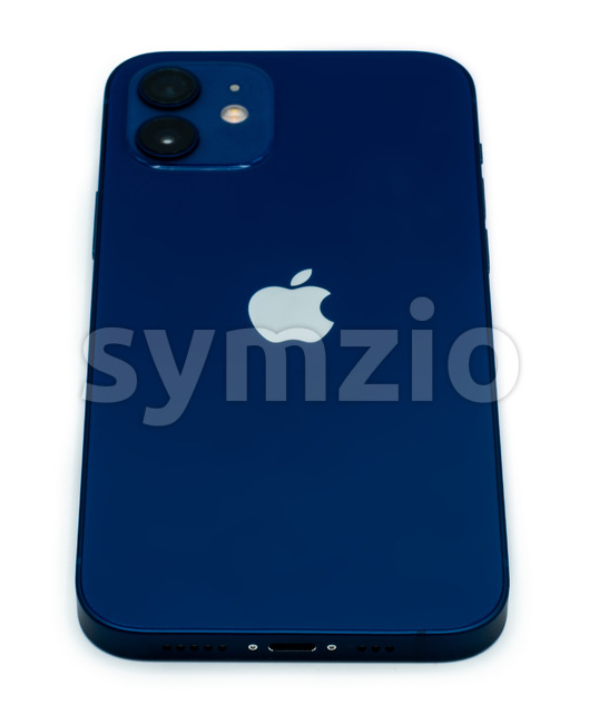 Ostfildern - Germany, December 5, 2020: Back of the Apple iPhone 12 in blue colour with slight shadows on perfectly white background. Stock Photo