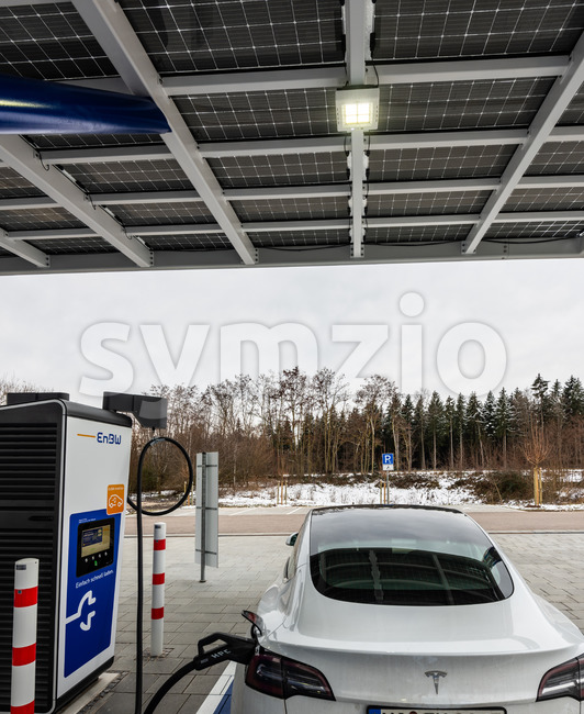Tesla charging at the newly opened electric vehicle charging station operated by EnBW in Rutesheim near Stuttgart at the highway A8. Stock Photo