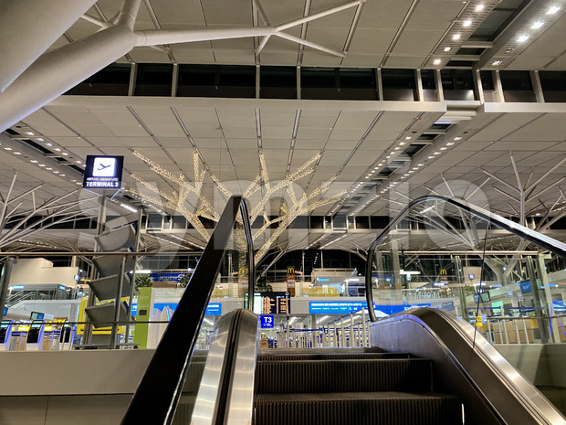Interiror of the Stuttgart Airport with Christmas decoration in the evening - the airport is pretty empty due to the Corona pandemic. Stock Photo