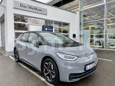 The new volkswagen id.3 electric car is charging at the Volkswagen car dealership in Augsburg, Germany. Stock Photo