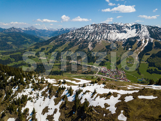 Aerial view on the village of Oberjoch in the Allgau Alps on a sunny day in May with last snow in the higher mountains Stock Photo