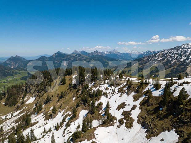 Aerial view on the Allgau Alps in Bavaria, Germany, on a sunny day in May with last snow in the higher mountains Stock Photo