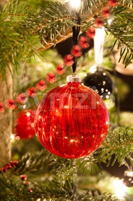 Decorative christmas balls and decoration hanging on pine - tree branch