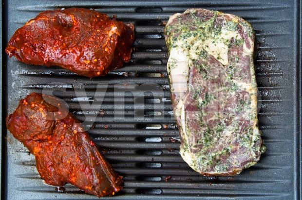 Steaks on the BBQ Stock Photo