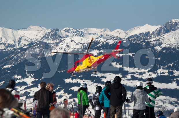 MONTAFON, AUSTRIA - FEBRUARY 29 :  A helicopter is flying an injured skier from the Montafon skiing area in ...