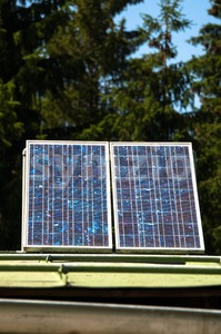 Mountain Cabin With Solar Panels Stock Photo