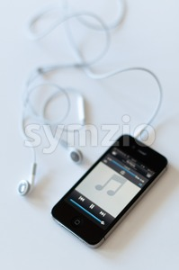 Apple iPhone 4s with audioplayer and earphones Stock Photo